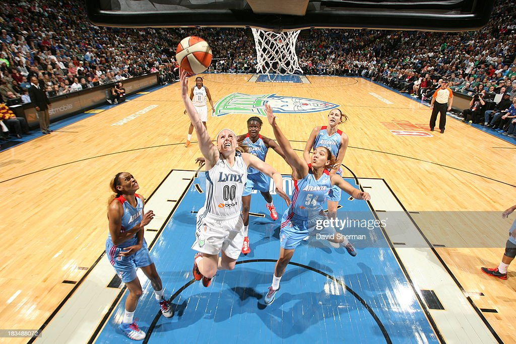 <a gi-track='captionPersonalityLinkClicked' href=/galleries/search?phrase=Lindsey+Moore&family=editorial&specificpeople=7542893 ng-click='$event.stopPropagation()'>Lindsey Moore</a> #00 of the Minnesota Lynx shoots a layup against Courtney Clements #54 of the Atlanta Dream during Game 1 of the 2013 WNBA Finals on October 6, 2013 at Target Center in Minneapolis, Minnesota.