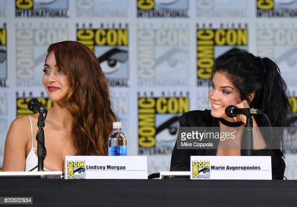 Lindsey Morgan and Marie Avgeropoulos speak onstage at ComicCon International 2017 'The 100' panel at San Diego Convention Center on July 21 2017 in...