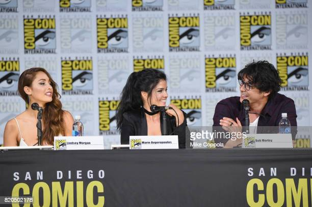 Lindsey Morgan Marie Avgeropoulos and Bob Morley speak onstage at ComicCon International 2017 'The 100' panel at San Diego Convention Center on July...