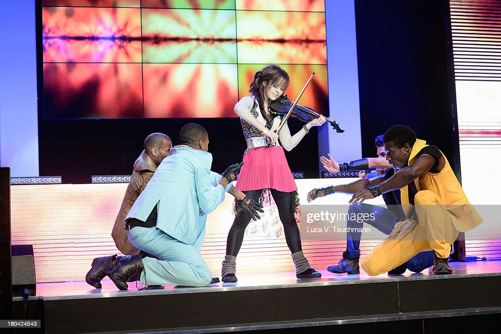 Lindsey Stirling performs at the Dreamball 2013 charity gala at Ritz Carlton on September 12, 2013 in Berlin, Germany.