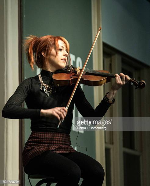 Lindsey Stirling performs before signing copies of 'The Only Pirate At The Party' at Barnes Noble Union Square on January 12 2016 in New York City