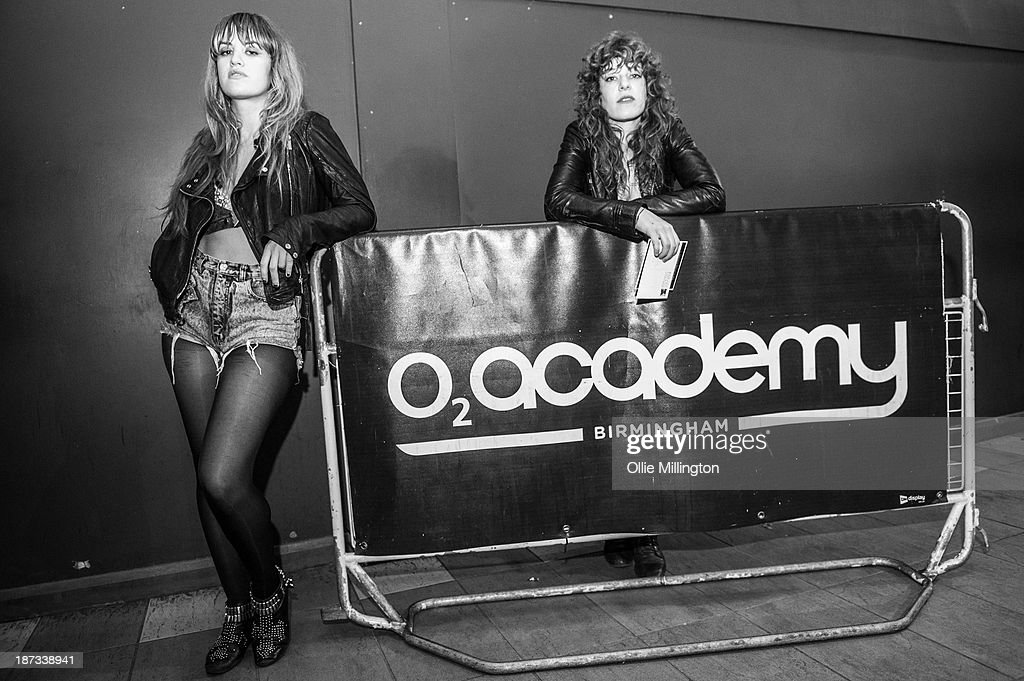 Lindsey Troy (L) and Julie Edwards of Deap Vally pose backstage after performing during the bands November 2013 UK tour at O2 Academy on November 7, 2013 in Birmingham, England.