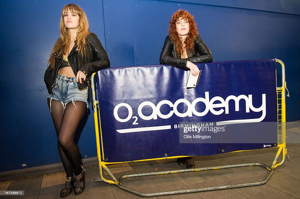 Lindsey Troy (L) and Julie Edwards of Deap Vally pose backstage for portraits after performing during the bands November 2013 UK tour at O2 Academy on November 7, 2013 in Birmingham, England.