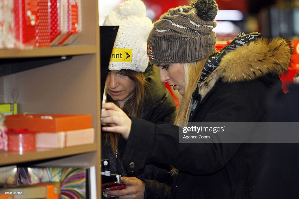 Lindsey Vonn (R) and Julia Mancuso of the Womens U.S. Ski Team spends an afternoon site seeing January 17. 2012 in Cortina d'Ampezzo, Italy.
