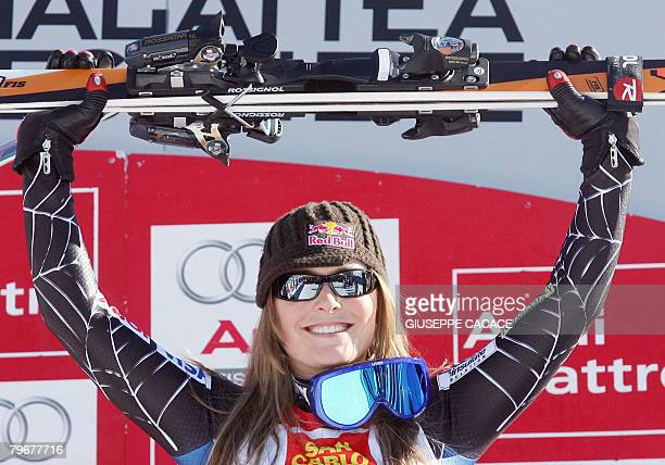 US Lindsey Vonn celebrates on the podium after winning the Women's ski worldcup Downhill race in Sestriere on February 9 2008 Vonn won the event...