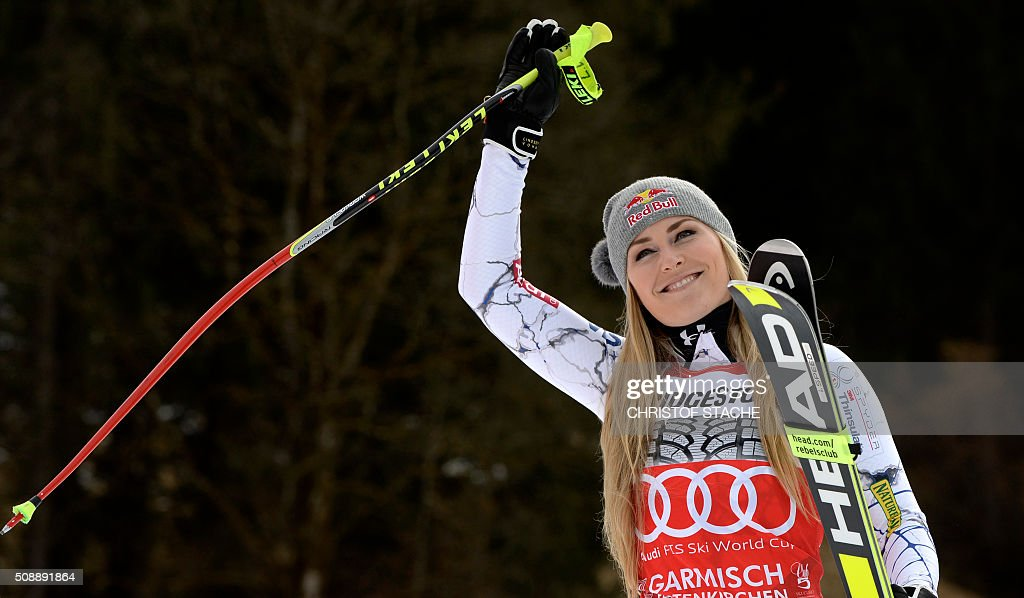 Lindsey Vonn from USA celebrates during the winner ceremony of the Ladies Super G competition race at the FIS Alpine Skiing World Cup in Garmisch-Partenkirchen, southern Germany, on February 7, 2016. Lara Gut from Switzerland won the competition, Viktoria Rebensburg from Germany placed second and Lindsey Vonn from USA placed third. / AFP / Christof STACHE