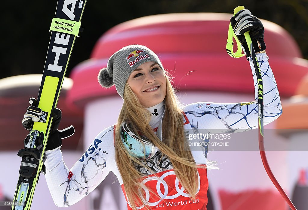 Lindsey Vonn from USA laughs during the winner ceremony after the ladies downhill competition race at the FIS Alpine Skiing World Cup in Garmisch-Partenkirchen, southern Germany, on February 6, 2016. Lindsey Vonn from USA won the competition, Fabienne Suter from Switzerland placed second and Viktoria Rebensburg from Germany placed third. / AFP / Christof STACHE
