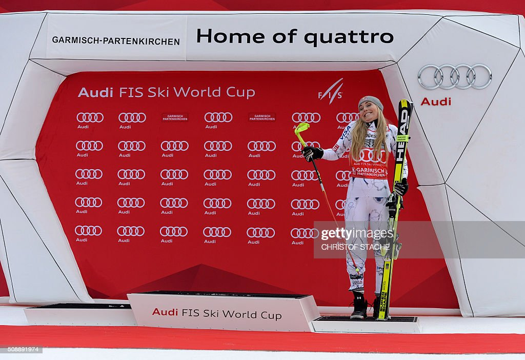 TOPSHOT Lindsey Vonn from USA reacts after she changed the podium position during the winner ceremony of the Ladies Super G competition race at the...