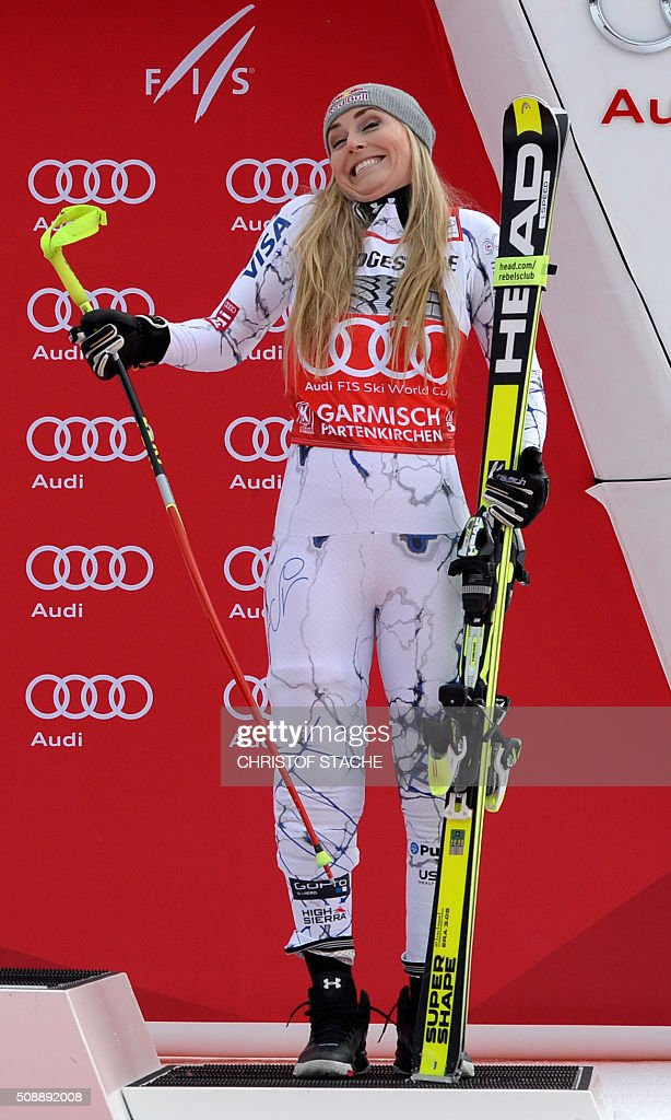 Lindsey Vonn from USA reacts after she changed the podium position during the winner ceremony of the Ladies Super G competition race at the FIS Alpine Skiing World Cup in Garmisch-Partenkirchen, southern Germany, on February 7, 2016. Lara Gut from Switzerland won the competition, Viktoria Rebensburg from Germany placed second and Lindsey Vonn from USA placed third. / AFP / Christof STACHE