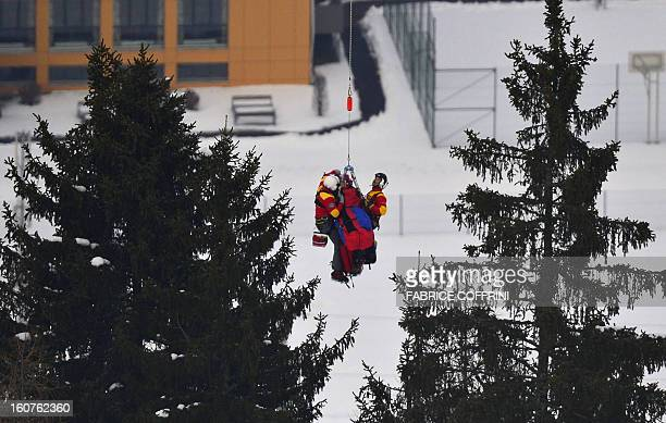 USA Lindsey Vonn is being lifted by a helicopter during the women's SuperG event of the 2013 Ski World Championships in Schladming Austria on...