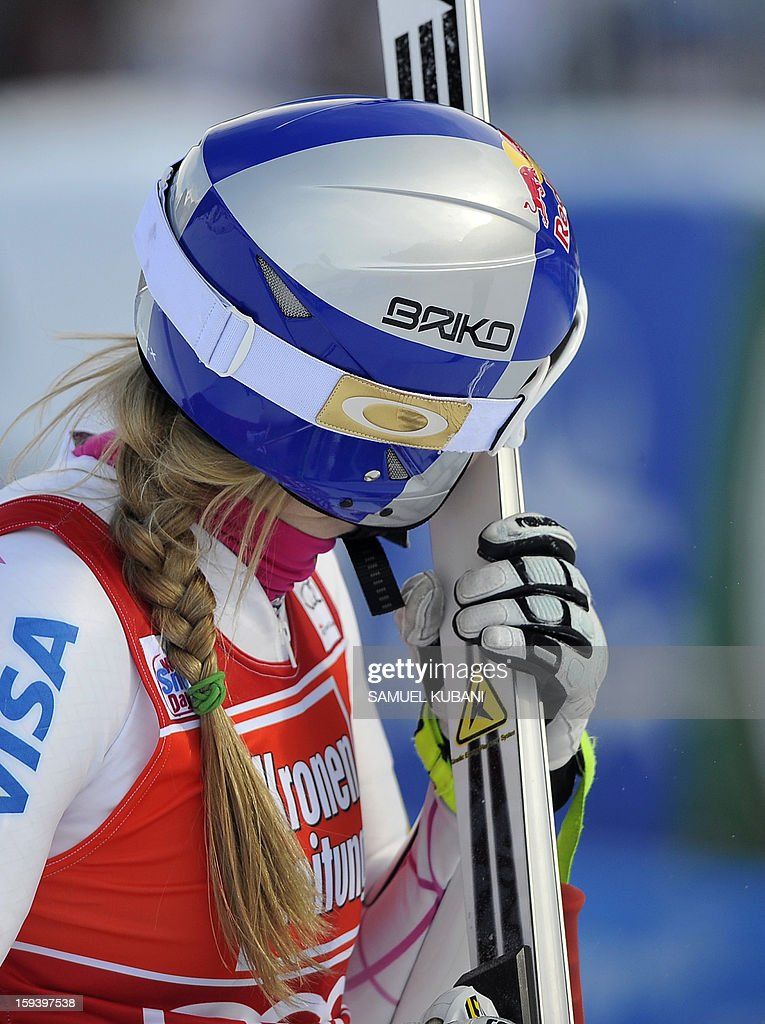 US Lindsey Vonn kisses her skies in finish area at the women's World Cup Super G, on January 13, 2013 in St Anton am Arlberg, Austria. Slovenia's Tina Maze won ahead of Austria's Anna Fenninger and Switzerland's Fabienne Suter.