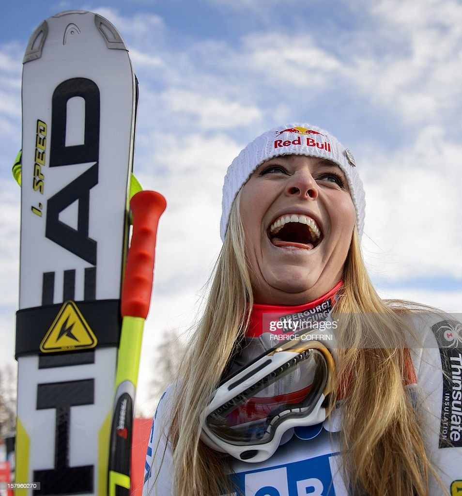 US Lindsey Vonn laughs in the finish area after wining the women's Alpine skiing World Cup super-G on December 8, 2012 in St. Moritz. Vonn won the race ahead of Slovenia's Tina Maze and fellow American Julia Mancuso. AFP PHOTO / FABRICE COFFRINI
