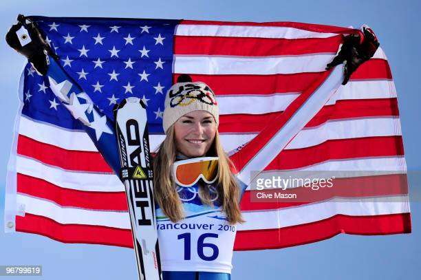 Lindsey Vonn of the United States celebrates winning the gold medal during the flower ceremony for the Alpine Skiing Ladies Downhill on day 6 of the...