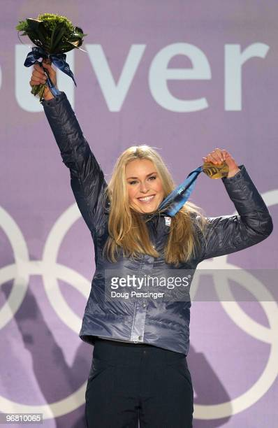 Lindsey Vonn of the United States celebrates with her gold medal during the medal ceremony for the Alpine Skiing Ladies Downhill on day 6 of the...