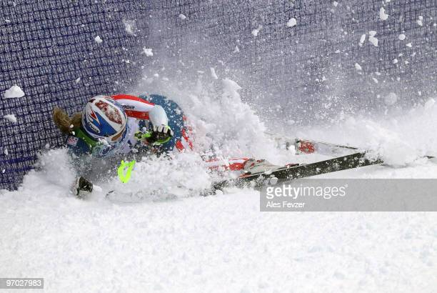 Lindsey Vonn of the United States crashes into the fence during the Ladies Giant Slalom first run on day 13 of the Vancouver 2010 Winter Olympics at...
