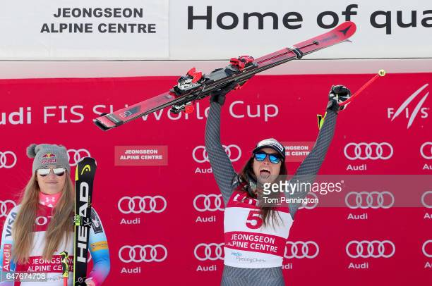 Lindsey Vonn of the United States in second place and Sofia Goggia of Italy in first place celebrate on the podium during the Audi FIS Ski World Cup...