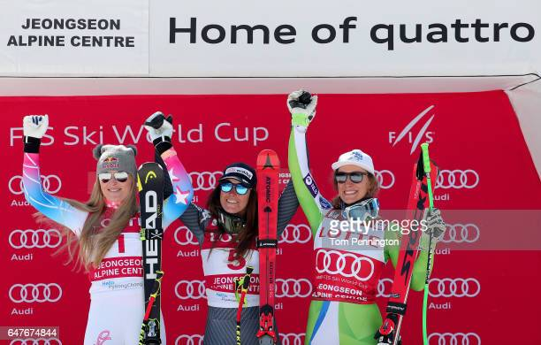 Lindsey Vonn of the United States in second place Sofia Goggia of Italy in first place and Ilka Stuhec of Slovenia in third place celebrate on the...