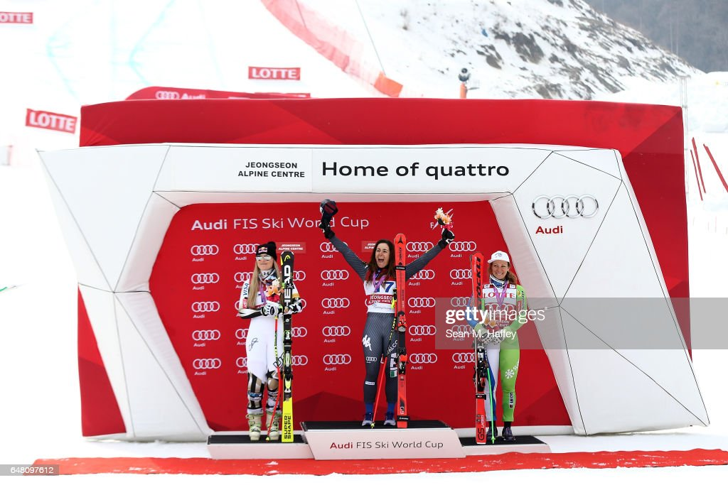 Lindsey Vonn of the United States in second place, Sofia Goggia of Italy in first place and Ilka Stuhec of Slovenia in third place celebrate on the podium during the Audi FIS Ski World Cup 2017 Ladies' Super-G on March 5, 2017 in Jeongseon-gun, South Korea.