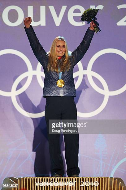 Lindsey Vonn of the United States reacts after receiving her gold medal during the medal ceremony for the Alpine Skiing Ladies Downhill on day 6 of...