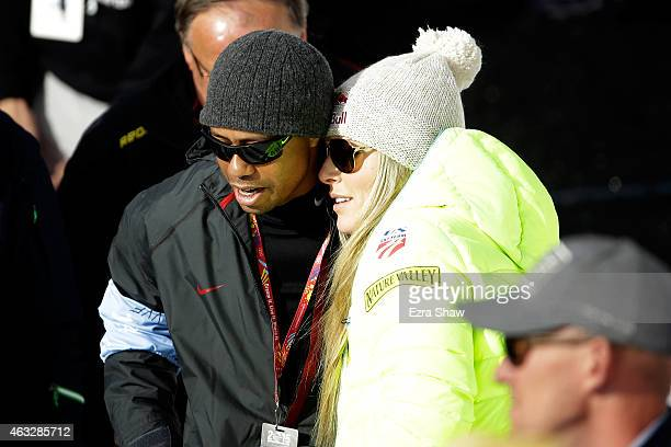 Lindsey Vonn of the United States speaks with boyfriend Tiger Woods after crossing the finish of the Ladies' Giant Slalom in Red Tail Stadium on Day...