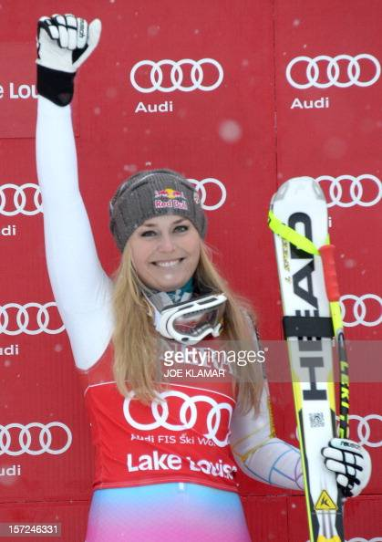 Lindsey Vonn of the US celebrates her victory during the women's downhill at the Alpine Skiing World Cup in Lake Louise on November 30 2012 Vonn won...
