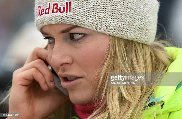 Lindsey Vonn of the US talks on a phone after winning the second women's downhill race during the Alpine Skiing FIS World Cup at Lake Louise Canada...