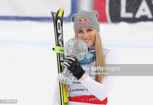 Lindsey Vonn of The USA poses with the crystal globe for overall downhill during the Audi FIS Alpine Skiing World Cup downhill on March 16 2016 in St...