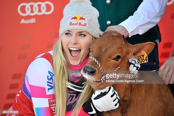 Lindsey Vonn of the USA takes 1st place and wins a cow named Winnie during the Audi FIS Alpine Ski World Cup Women's Downhill on December 20 2014 in...