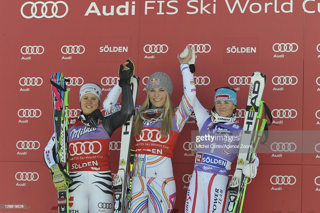 Lindsey Vonn of the USA takes 1st place, Viktoria Rebensburg of Germany takes 2nd place, Elisabeth Goergl of Austria takes 3rd place during the Audi FIS Alpine Ski World Cup Women's Giant Slalom on October 22, 2011 in Soelden, Austria.