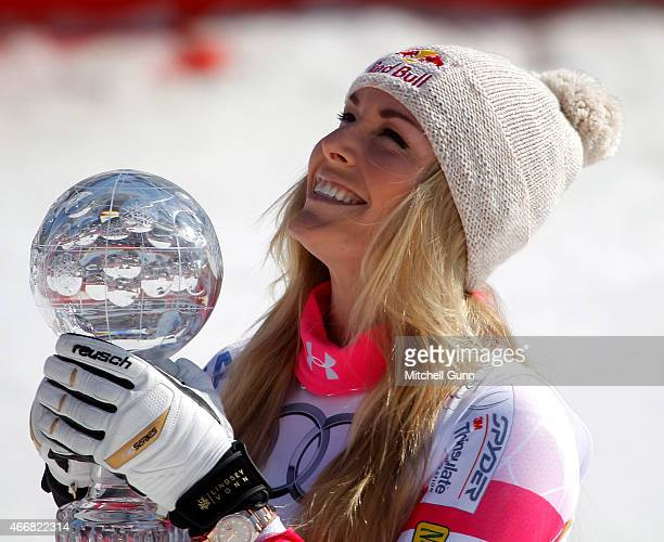Lindsey Vonn of the USA with the trophy for overall Super G winner in the finish area of the FIS Alpine Ski World Cup women's SuperG race on March 19...