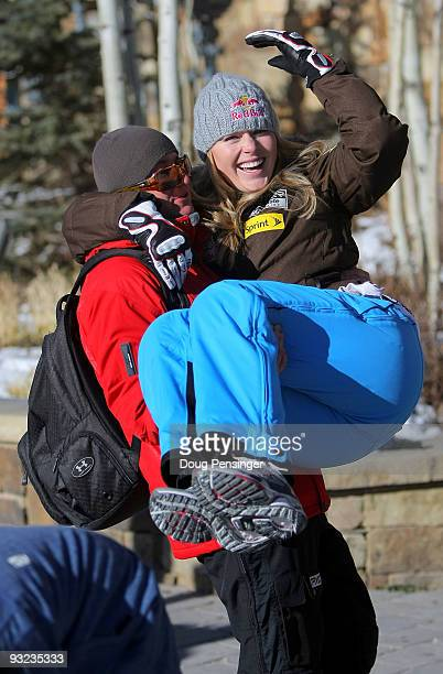 Lindsey Vonn of the Women's US Alpine Ski Team gets a lift from her personal trainer Martin Hager during media day on November 19 2009 in Copper...