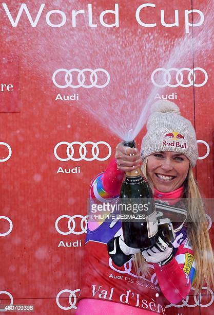 US Lindsey Vonn sprays champagne as she celebrates her gold medal during the podium ceremony after winning the FIS Alpine World Cup Women's Downhill...