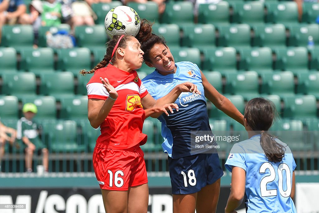 Lindsi Cutshall #18 of Sky Blue FC and Jaelene Hinkle #16 of Western New York Flash battle for a loose ball during the first half at Sahlen's Stadium on July 19, 2015 in Rochester, New York.