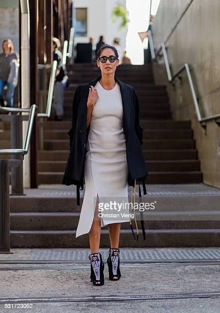 Lindy Klim wearing a white Ginger Smart dress a black Ellery jacket a black Yves Saint Laurent bag and Louboutin heels outside Ginger Smart at...