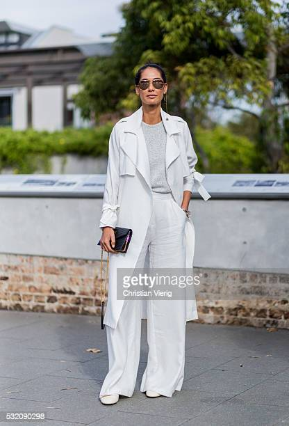 Lindy Klim wearing Linda Farrow sunglasses a white Viktoria Woods trench coat and wide leg pants outside Kitx at MercedesBenz Fashion Week Resort 17...