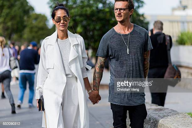 Lindy Klim wearing Linda Farrow sunglasses a white Viktoria Woods trench coat and wide leg pants and Adam Ellis wearing a grey tshirt outside Kitx at...