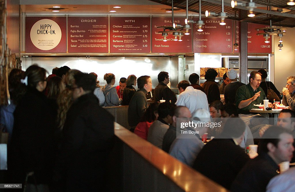 A line and crowd of people are seen inside a Chipotle restaurant December 2, 2005 in Glenview, Illinois. McDonald's Corp., owners of 92 percent of Chipotle, are preparing its Mexican-style eateries for an initial public offering.