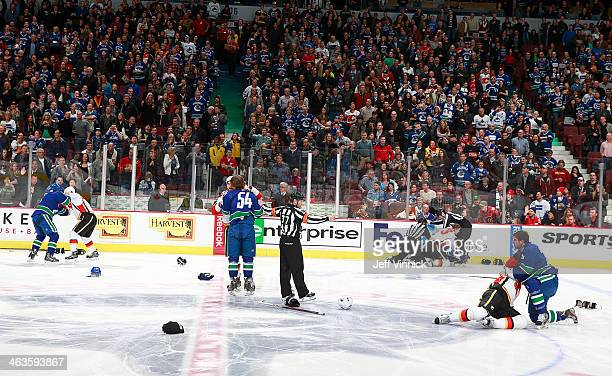 A line brawl between the Vancouver Canucks and the Calgary Flames broke out at the start of their NHL game at Rogers Arena January 18 2014 in...