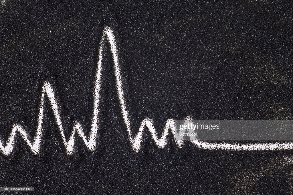 Line depicting heartbeat drawn in sand : Stock Photo