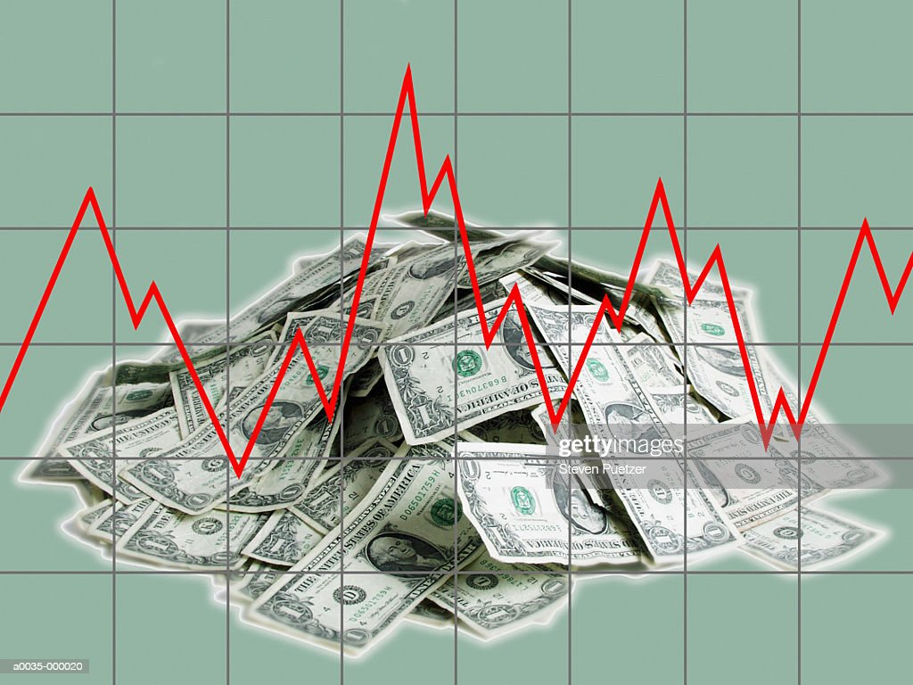 Line Graph and Stack of Notes : Stock Photo
