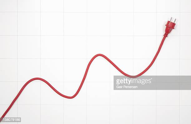 Line graph chart with electrical cable and plug