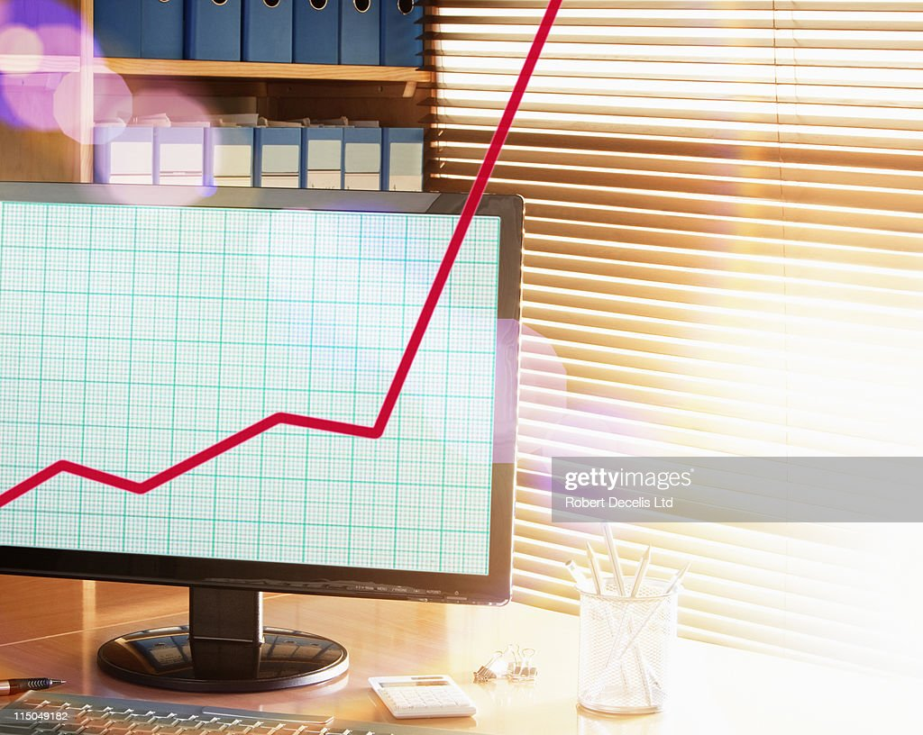 Line graph going off the computer screen. : Stock Photo