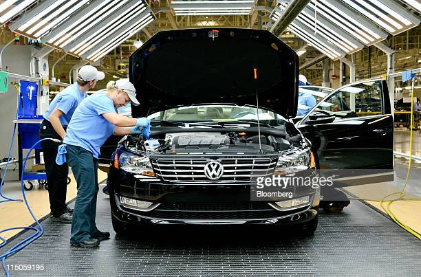 Line inspection workers check out a Volkswagen AG 2012 Passat at the company's factory in Chattanooga Tennessee US on Wednesday June 1 2011...