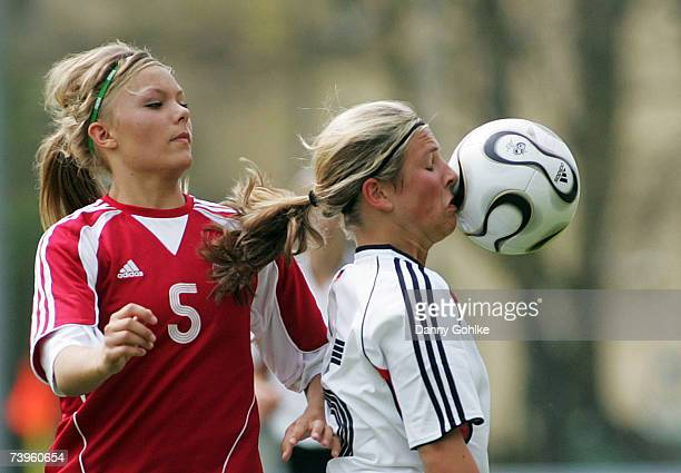 Line Jensen of Denmark and Sarah Schroeder of Germany battle for the ball during the women's Under 17 international friendly match between Germany...