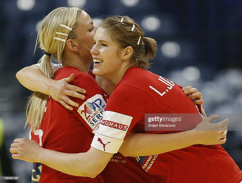 Line Jorgensen (R) and Pernille Holst Larsen (L) of Denmark celebrate victory against Czech Republic of Denmark during the Women's European Handball Championship 2012 Group I main round match between Czech Republic and Denmark at Arena Hall on December 10, 2012 in Belgrade, Serbia.