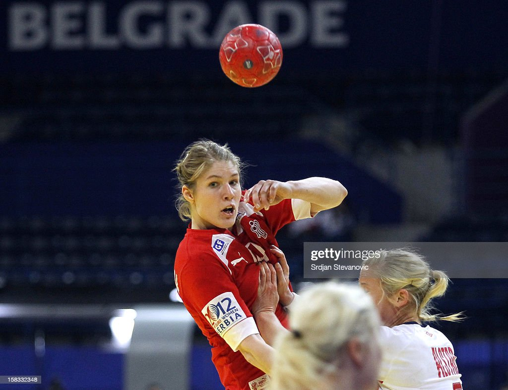 Line Jorgensen (L) of Denmark is challenged ByIda Alstad (R) of Norway during the Women's European Handball Championship 2012 Group I main round match between Norway and Denmark at Arena Hall on December 13, 2012 in Belgrade, Serbia.