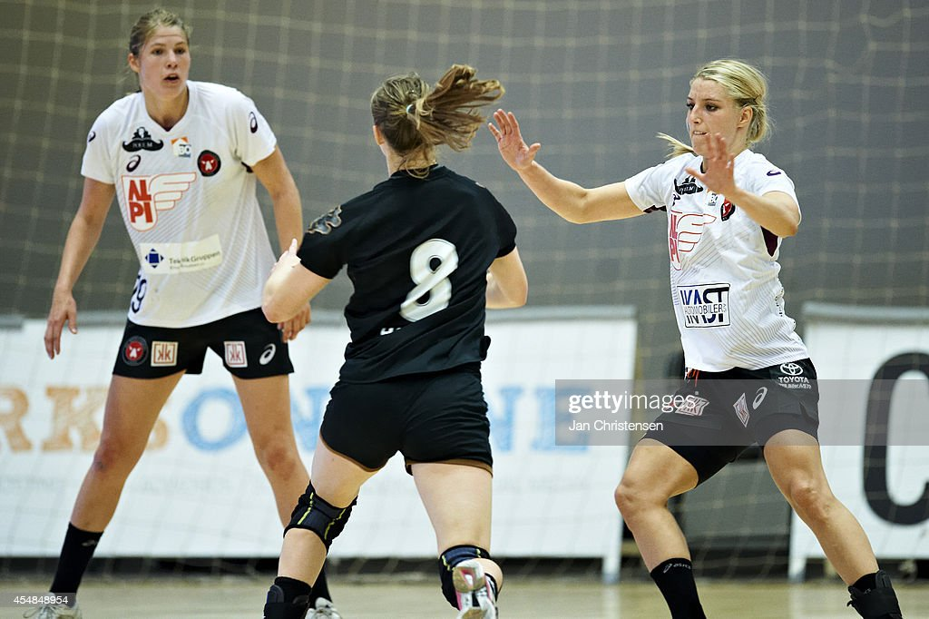 Line Jorgensen of FC Midtjylland (L) and Nycke Groot of FC Midtjylland defends during the Danish Handball Liga match between Copenhagen Handball and FC Midtjylland in Frederiksberg Hallen on September 06, 2014 in Copenhagen, Denmark.