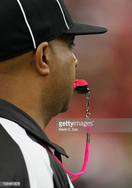 Line judge Adrian Hill blows a pink whistle in recognition of Breast Cancer Awareness Month during the game between the San Francisco 49ers and the...