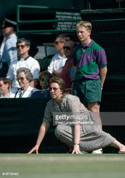 A line judge and ball boy in action during the Wimbledon Lawn Tennis championships in London circa 1993