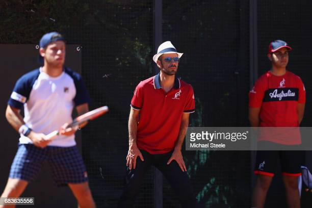 Line judge and ball boy look on as Diego Schwartzman of Argentina plays his first round match against Jack Sock of USA on Day Three of The...